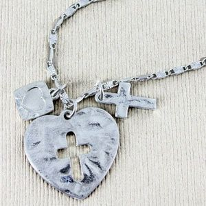 Jewelry - SILVERTONE CUT-OUT CROSS HEART WITH CHARMS NECKLAC
